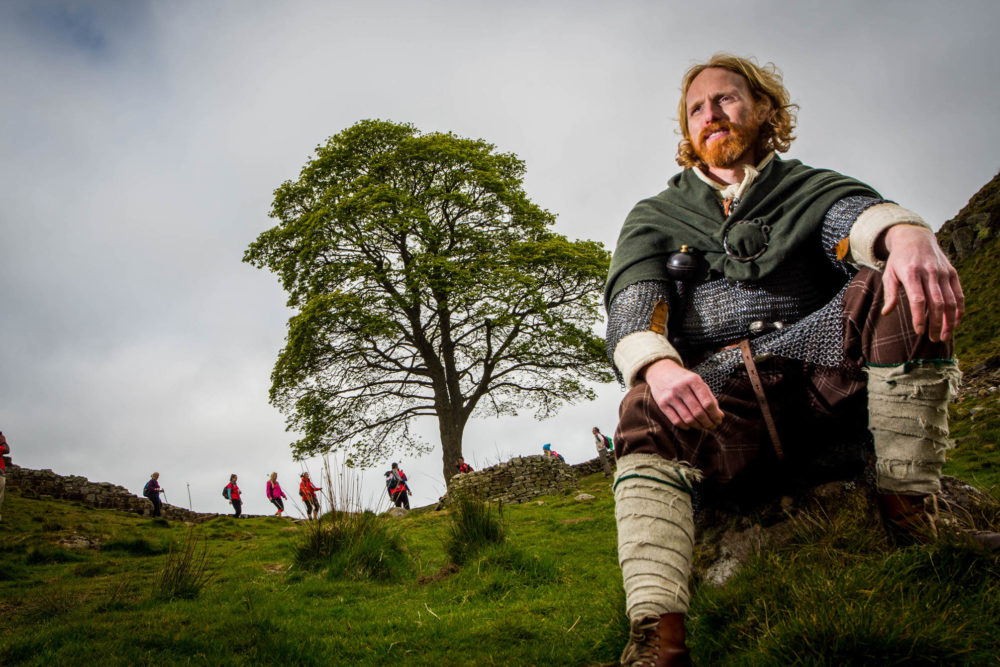 A Roman sitting at Sycamore Gap on Hadrian's Wall